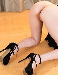 Aya Kisaki posing in her extremely revealing black dress on the floor