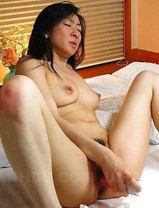 Emiko Koike pleases herself on bed