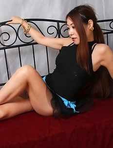 Miho Kuroki shows sexy legs under black dress in her bed