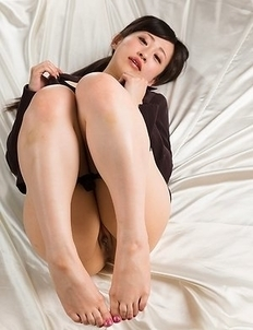 Stunning brunette Yui Kyouno jerks this guy off with her soft/sexy feet