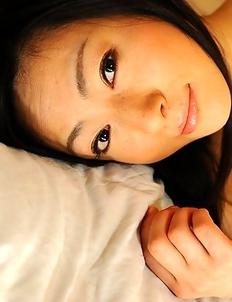 Lustful Emiko Koike teases on bed