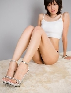 Ravishing Ryo Yuuki posing with her legs high up on the bed, she's too hot