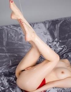 Yuma Miyazaki posing in black stockings and heels, looking seductive as fuck